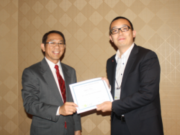 Xianjie (Tony) Ren receives award at AAIC